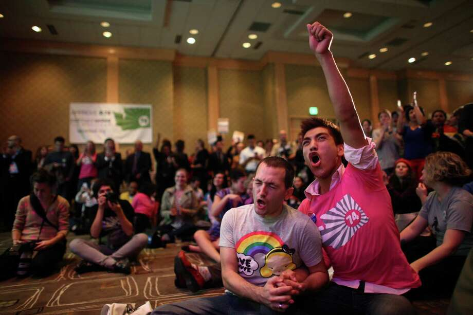 Brian Oberdan, left, and partner Loui Love celebrate during an 