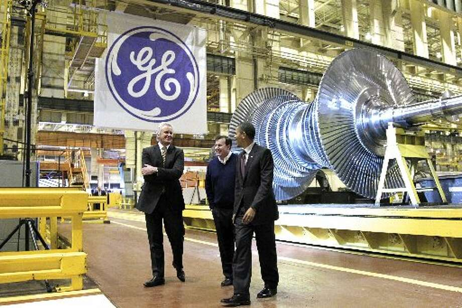 Jeff Immelt, Obama's Jobs Czar, seen here on a tour with President in January of 2011.GE's share gained 0.84 percent to $21.59 as voters decided Obama's political fate. (Associated Press J. Scott Applewhite / AP)