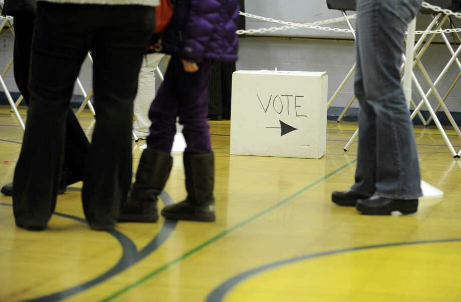 Voting Tuesday, Nov. 6, 2012 at Elizabeth Shelton School in Shelton, Conn. Photo: Autumn Driscoll / Connecticut Post