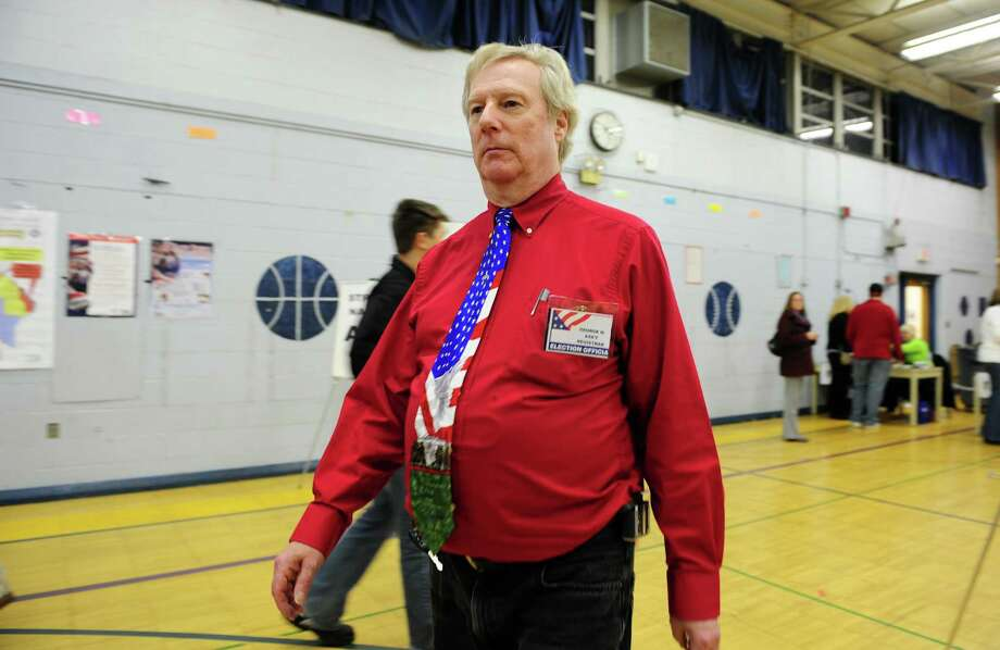 Assistant Registrar George Harvey works at the polls Tuesday, Nov. 6, 2012 at Elizabeth Shelton School in Shelton, Conn. Photo: Autumn Driscoll / Connecticut Post