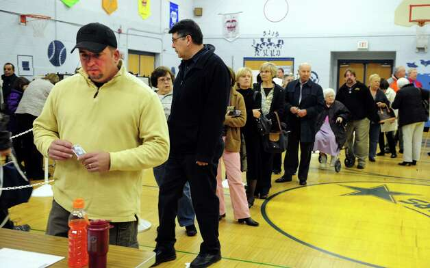 Drew Sedlock votes Tuesday, Nov. 6, 2012 at Elizabeth Shelton School in Shelton, Conn. Photo: Autumn Driscoll / Connecticut Post