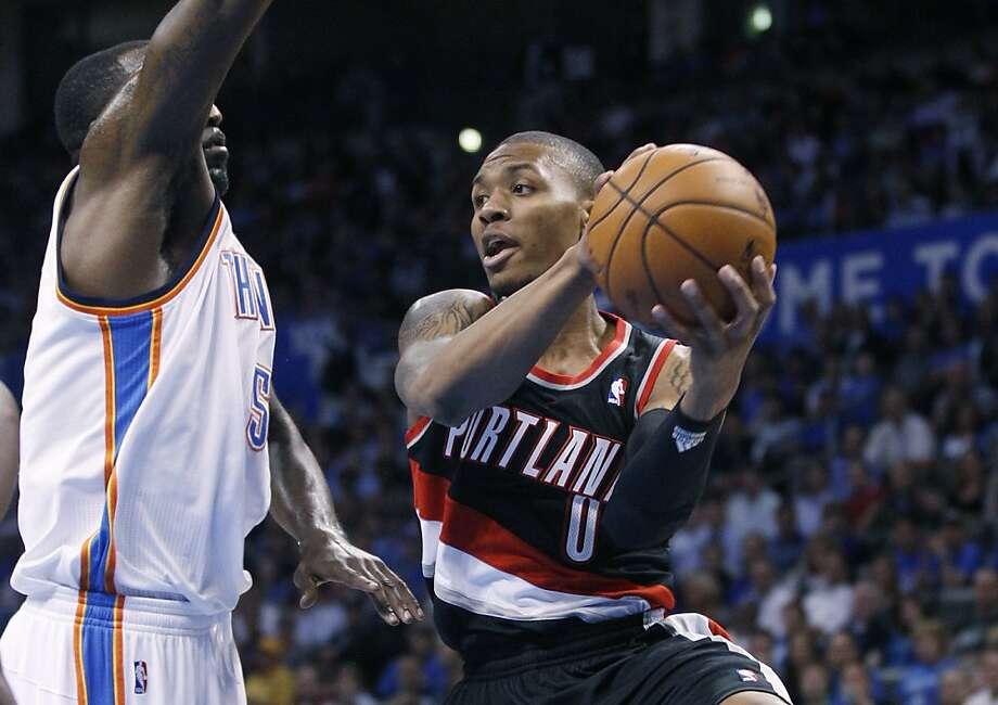 Portland's Damian Lillard (Oakland High) leads all NBA rookies in scoring, assists and minutes. Photo: Sue Ogrocki, Associated Press