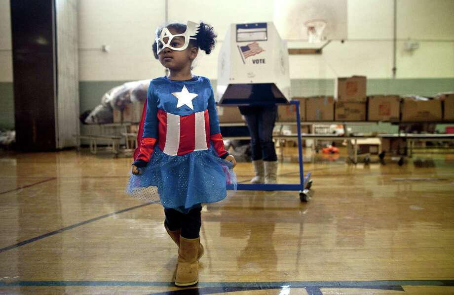 NEW YORK, NY- NOVEMBER 06: Raena Lamont, 3, wears a Captain America at a polling center doubling as a donation site November 6, 2012 in the Staten Island borough of New York City. As Staten Island continues to recover from Superstorm Sandy, a few polling stations have been relocated due to power outages or ongoing use as an evacuation center. (Photo by Allison Joyce/Getty Images)  *** BESTPIX *** Photo: Allison Joyce, Getty Images / 2012 Getty Images
