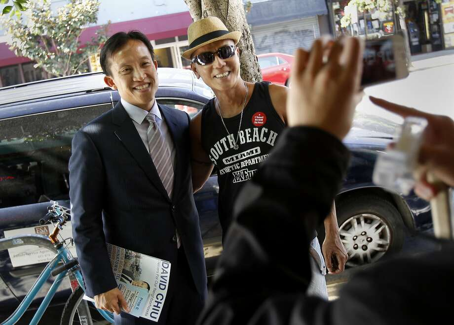 Giap Pham (right) stopped to have his picture taken with Supervisor David Chiu. San Francisco Board of Supervisors President David Chiu and a handful of supporters canvassed the middle Polk Street area encouraging voters to support Prop. E on election day Tuesday November 6, 2012. Photo: Brant Ward, The Chronicle