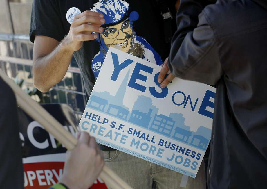 Supervisor David Chiu and his supporters handed out Yes on E posters to businesses on Polk Street. San Francisco Board of Supervisors President David Chiu and a handful of supporters canvassed the middle Polk Street area encouraging voters to support Prop. E on election day Tuesday November 6, 2012. Photo: Brant Ward, The Chronicle