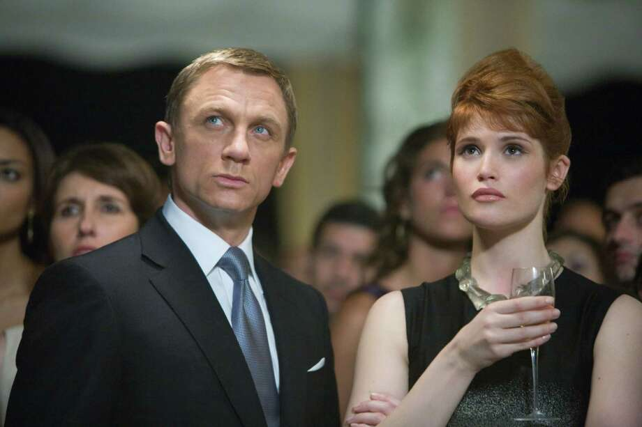 "This undated image provided by Sony Pictures shows Daniel Craig, James Bond, and Gemma Arterton, Agent Fields, infiltrate a fundraising party in Bolivia during a scene from the movie Quantum of Solace being shot in Panama City, Panama. Picking up an hour after ""Casino Royale"" left off, ""Quantum of Solace"" is the spy franchise's first direct sequel. Filming began in January and has taken the crew from Britain to Panama to a moonlike landscape in northern Chile, which is standing in for Bolivia. It's a place that director Marc Forster said evokes Bond's ""isolation and loneliness. Photo: Karen Ballard, AP / Sony Pictures"