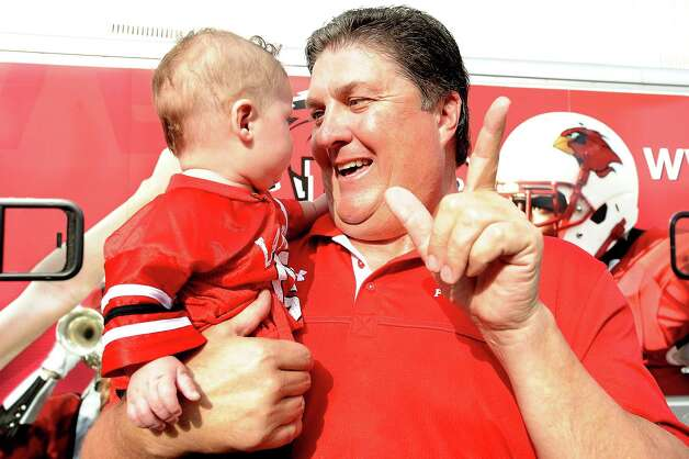 Lamar University coach Ray Woodard and his grandson, Trey, make an entrance into Provost Umphrey  Stadium on Saturday, September 8, 2012. Photo taken: Randy Edwards/The Enterprise