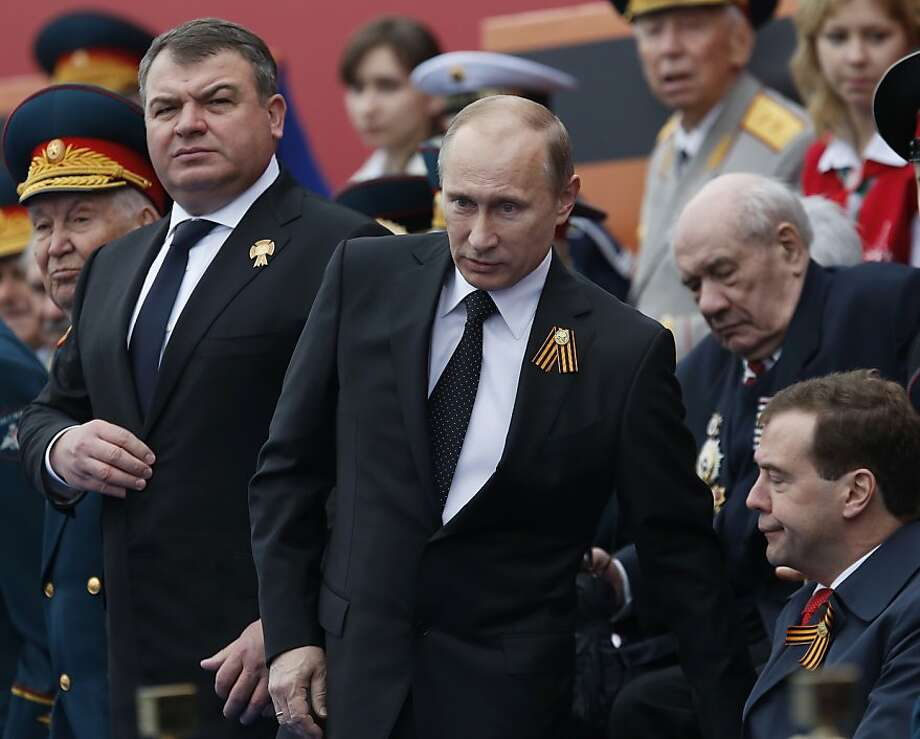 Fired defense chief Anatoly Serdyukov (left) was a longtime ally of President Vladimir Putin (center). Photo: Alexander Zemlianichenko, Associated Press