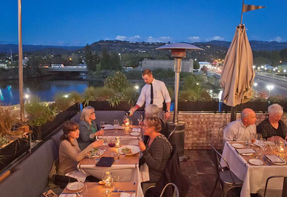 Diners eat dinner on the roof of The Thomas in Napa. Photo: John Storey, Special To The Chronicle