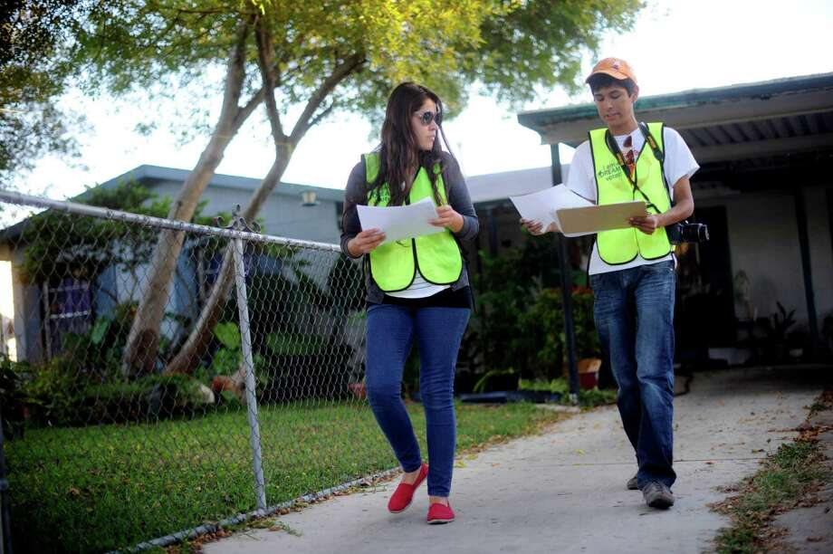 Diana Ramirez, left, and William Wise canvas along Barbuda Street in the hope of convincing registered voters who have not gone to the polls to vote for candidates in favor of the Dream Act on election day, Nov. 6, 2012. The Dream Act would gives some undocumented immigrants brought to the United States as children a path toward legal status. Photo: Billy Calzada, San Antonio Express-News / © 2012 San Antonio Express-News