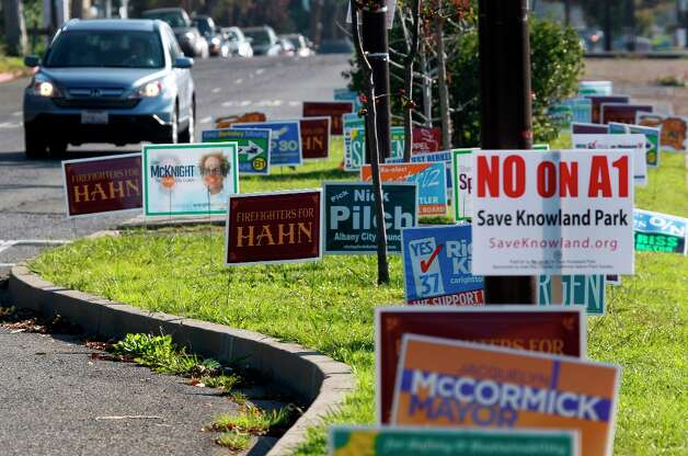 Lawn signs from a countless number of campaigns fill the median strip on Sacramento Street in Berkeley, Calif. on Tuesday, Nov. 6, 2012. Photo: Paul Chinn, The Chronicle / ONLINE_YES