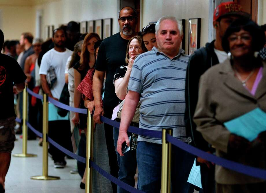 Dozens of voters wait in line to mark their ballots in the basement of City Hall in San Francisco, Calif. on Tuesday, Nov. 6, 2012. Photo: Paul Chinn, The Chronicle / ONLINE_YES
