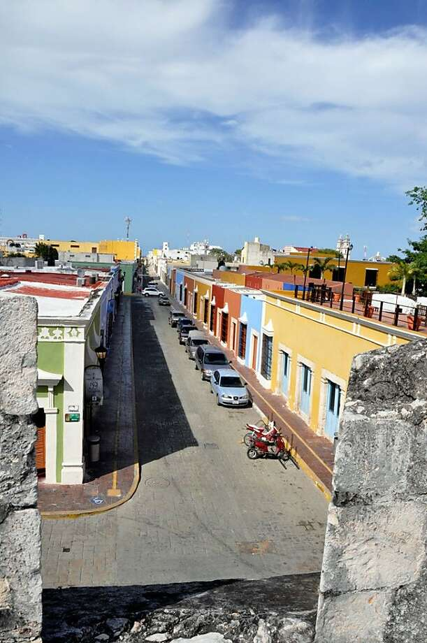 Pastel-colored houses are on display in Campeche, where visitors will encounter affordable lodgings and friendly residents. Photo: Christine Delsol, Special To SFGate