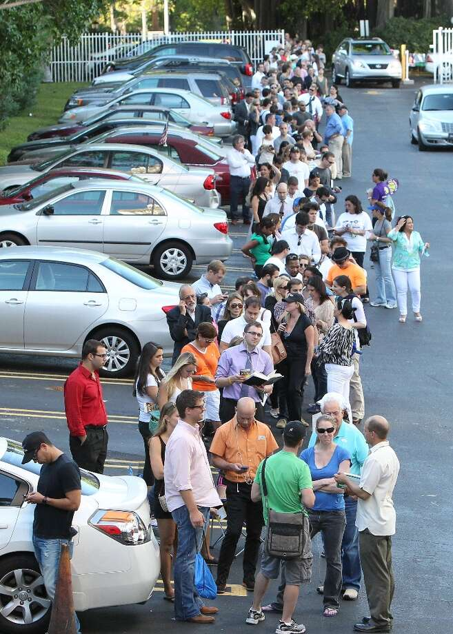 People wait in line to vote in Miami on Election Day Tuesday, Nov. 6, 2012. (AP Photo/El Nuevo Herald, David Santiago)  MAGS OUT Photo: David Santiago, Associated Press / El Nuevo Herald