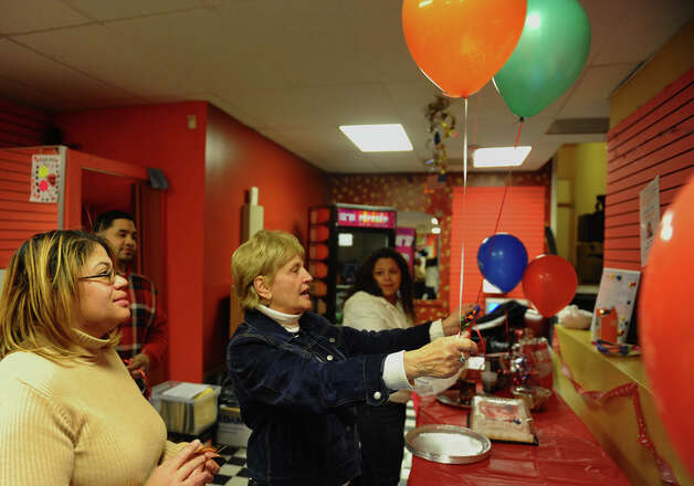 Dottie Guman, Vice-President of the Bridgeport Democratic Town Committee, helps place balloons as campaign volunteer Aidee Nieves looks on, at candidate Christina Ayala's headquarters on East Main Street in Bridgeport, Conn. on Tuesday November 6, 2012. Ayala is the expected winner for the state representative seat in the 128th district. Photo: Christian Abraham / Connecticut Post