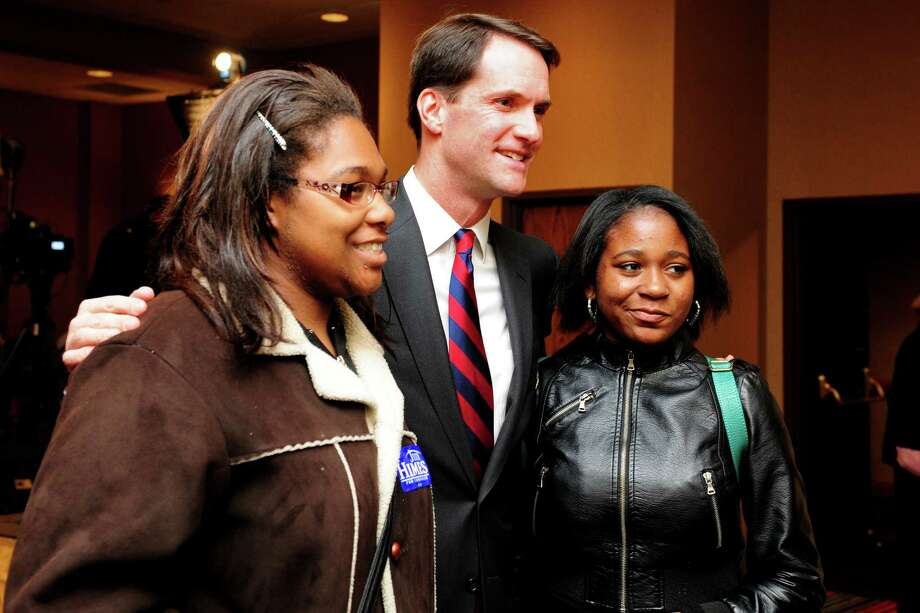 Congressman Jim Himes (D-4th) takes a picture with Rishera Hopkins, 17, a student at Harding, and Destiny Smalls, 17, a student at Central, Tuesday, Nov. 6, 2012 at the Holiday Inn in Bridgeport, Conn. Photo: Autumn Driscoll / Connecticut Post