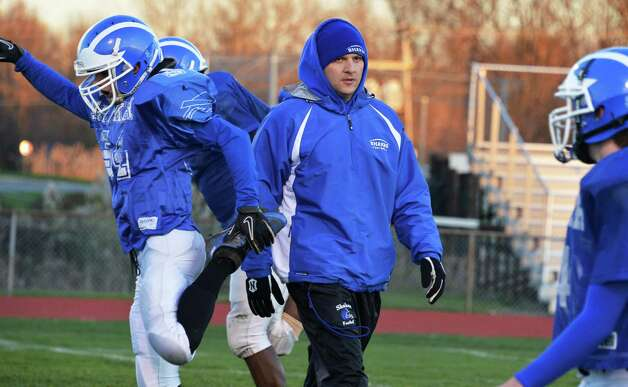 Shaker head coach Greg Sheeler, center, oversees football practice at the school in Colonie Tuesday Nov. 6, 2012. This is the first time the school is practicing in November as the Blue Bison prepare for their upcoming state semifinal game.  (John Carl D'Annibale / Times Union) Photo: John Carl D'Annibale / 00019993A