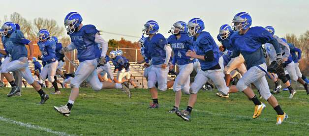 Shaker High's football team practices at the school in Colonie Tuesday Nov. 6, 2012. This is the first time the school is practicing in November as the Blue Bison prepare for their upcoming state semifinal game.  (John Carl D'Annibale / Times Union) Photo: John Carl D'Annibale / 00019993A
