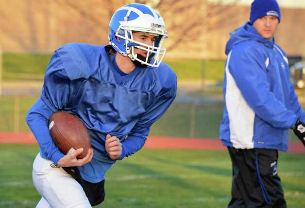 "Shaker quarterback ""CJ"" Landers head drills under the watchful eye of coach Greg Sheeler, at right, during practice at the school in Colonie Tuesday Nov. 6, 2012. This is the first time the school is practicing in November as the Blue Bison prepare for their upcoming state semifinal game.  (John Carl D'Annibale / Times Union) Photo: John Carl D'Annibale / 00019993A"