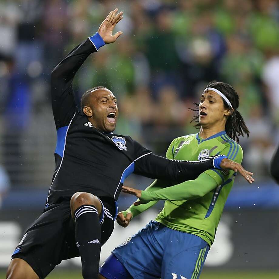 SEATTLE, WA - SEPTEMBER 22: Victor Bernardez #26 of the San Jose Earthquakes battles Fredy Montero #17 of the Seattle Sounders at CenturyLink Field on September 22, 2012 in Seattle, Washington. (Photo by Otto Greule Jr/Getty Images) Photo: Otto Greule Jr, Getty Images