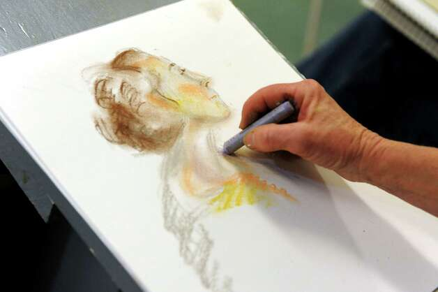 Tracy Wall of Porter Corners draws a portrait using colored chalk during a regular sketch club gathering on Monday, Oct. 22, 2012, at The Arts Center in Saratoga Springs, N.Y. (Cindy Schultz / Times Union) Photo: Cindy Schultz