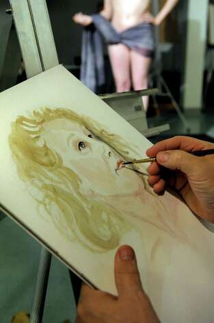 Steve Sanford of South Cambridge does a watercolor portrait of figure model Gina Marie Cannistraro during a regular sketch club gathering on Monday, Oct. 22, 2012, at The Arts Center in Saratoga Springs, N.Y. (Cindy Schultz / Times Union) Photo: Cindy Schultz