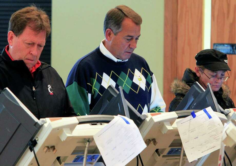 Speaker John Boehner, R-Ohio, center, votes at Ronald Reagan Lodge, Tuesday, Nov. 6, 2012, in West Chester, Ohio.  After a grinding presidential campaign, Americans head into polling places across the country.  (AP Photo/Al Behrman) Photo: Al Behrman, STF / AP
