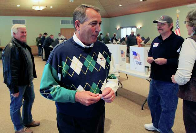 House Speaker John Boehner (R-Ohio) talks with poll workers after voting at Ronald Reagan Lodge, Tuesday, Nov. 6, 2012, in West Chester, Ohio. (AP Photo/Al Behrman) Photo: Al Behrman, STF / AP