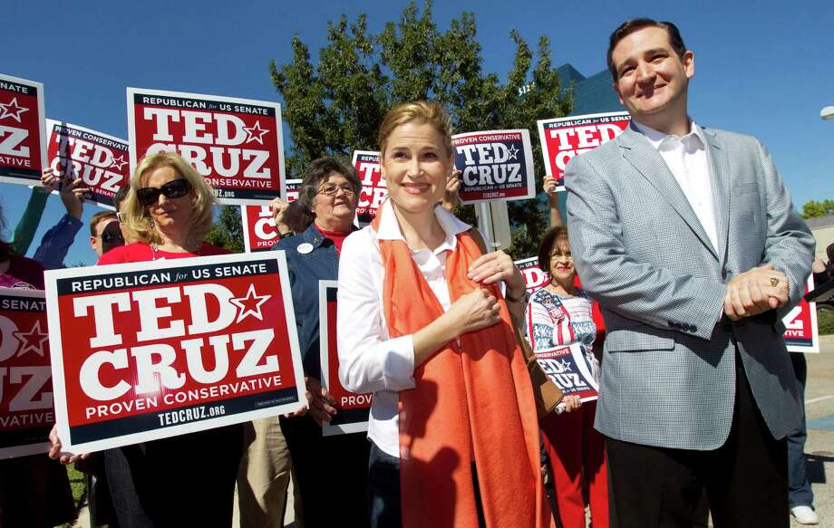 "Ted Cruz and his wife, Heidi, greet supporters on Tuesday outside St. Martin's Episcopal Church. Cruz said he spent the morning ""praying and reading the Bible"" in preparation for his new challenge. Photo: Brett Coomer, Houston Chronicle / © 2012 Houston Chronicle"