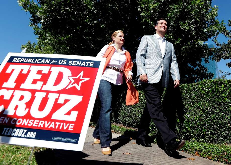 Republican candidate for U.S. Senate Ted Cruz and his wife Heidi arrive outside a polling location to talk with the media Tuesday, Nov. 6, 2012, in Houston. Cruz is running against Democrat Paul Sadler to replace retiring U.S. Sen. Kay Bailey Hutchison. (AP Photo/David J. Phillip) Photo: David J. Phillip, Associated Press / AP