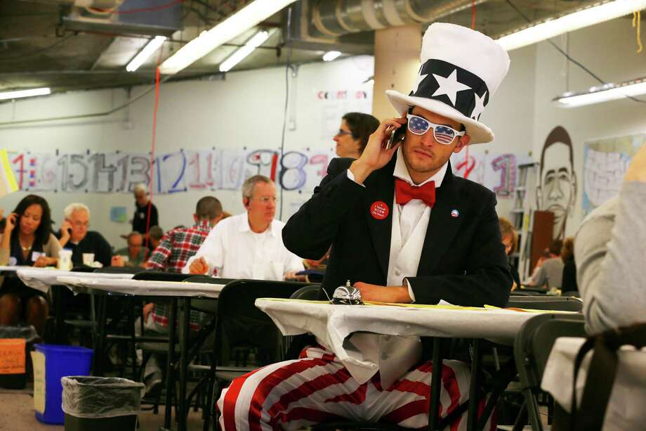Nick Wardle, right, makes calls to voters  urging them to vote for President Barack Obama at an Obama for America  phone bank in San Francisco, on Election Day, Nov. 6, 2012. Photo: JIM WILSON, New York Times / NYTNS