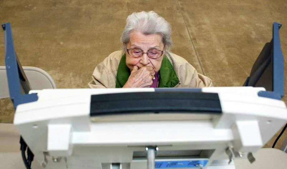 Alvina DeVault takes a moment to contemplate her choices while voting at the Tippecanoe County Fairgrounds, in Lafayette, Ind., on Tuesday, Nov. 6, 2012.  The  91-year-old DeVault hasn't missed casting her ballot in an election since Franklin D. Roosevelt was president. Photo: Brent Drinkut/Journal & Courier, Associated Press / Jorunal & Courier