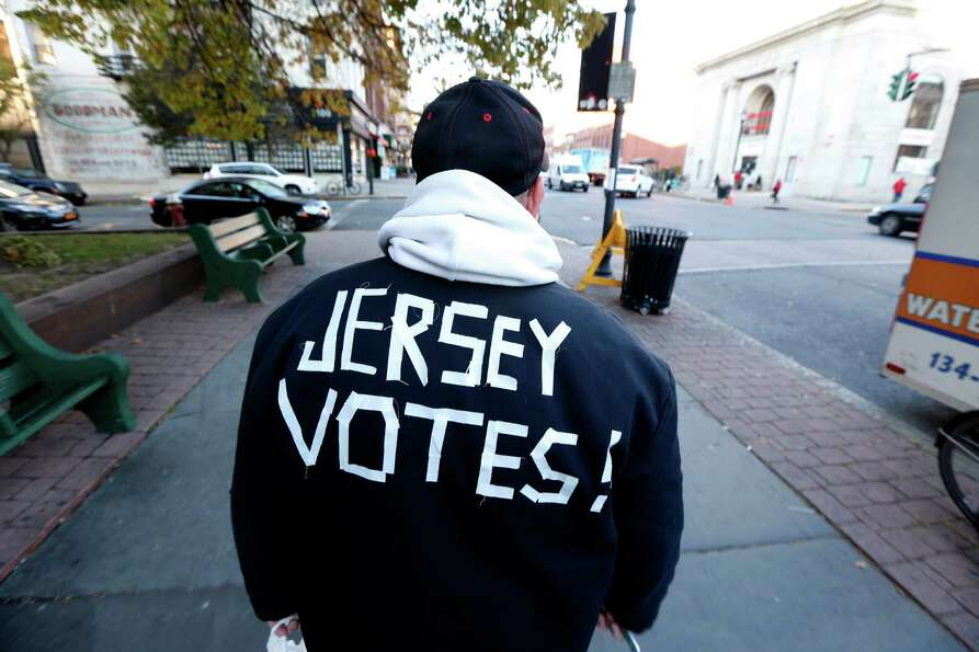 Ed Lippman, 58, wears a message on his jacket on Election Day while walking home, Tuesday, Nov. 6, 2