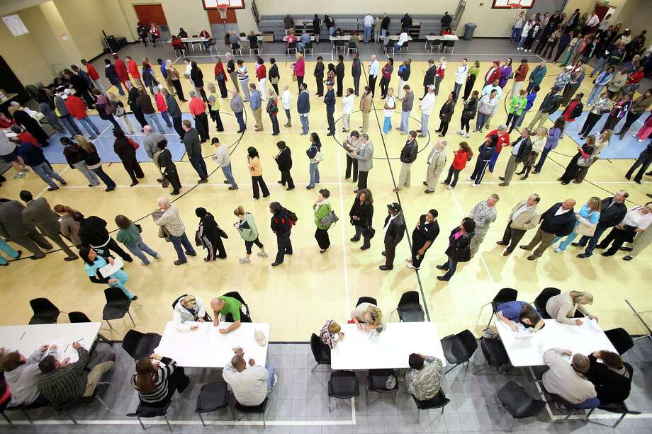 Voters wait in line at the Bobby Miller Activity Center in Tuscaloosa, Ala., Tuesday, Nov. 6, 2012. Voters in record numbers flocked to the poles Tuesday to cast their votes. Photo: Dusty Compton, Associated Press / Tuscaloosa News