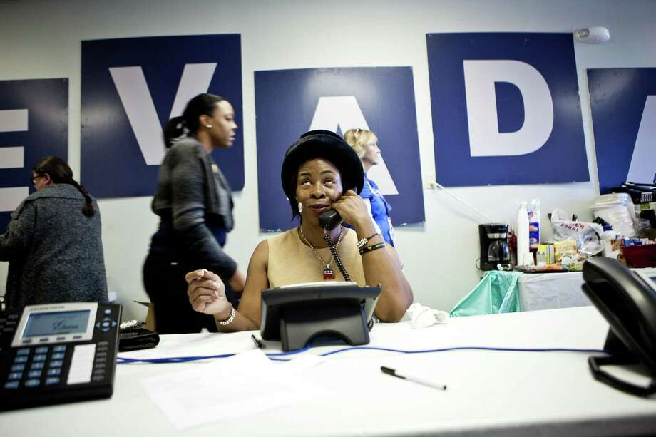 Ora Thornton calls voters at a Romney/Ryan campaign phone bank November 6, 2012 in Reno, Nevada.  As Americans go to vote, President Barack Obama and Republican nominee former Massachusetts Gov. Mitt Romney remain in a virtual tie in the national polls. Photo: Max Whittaker, Getty Images / 2012 Getty Images