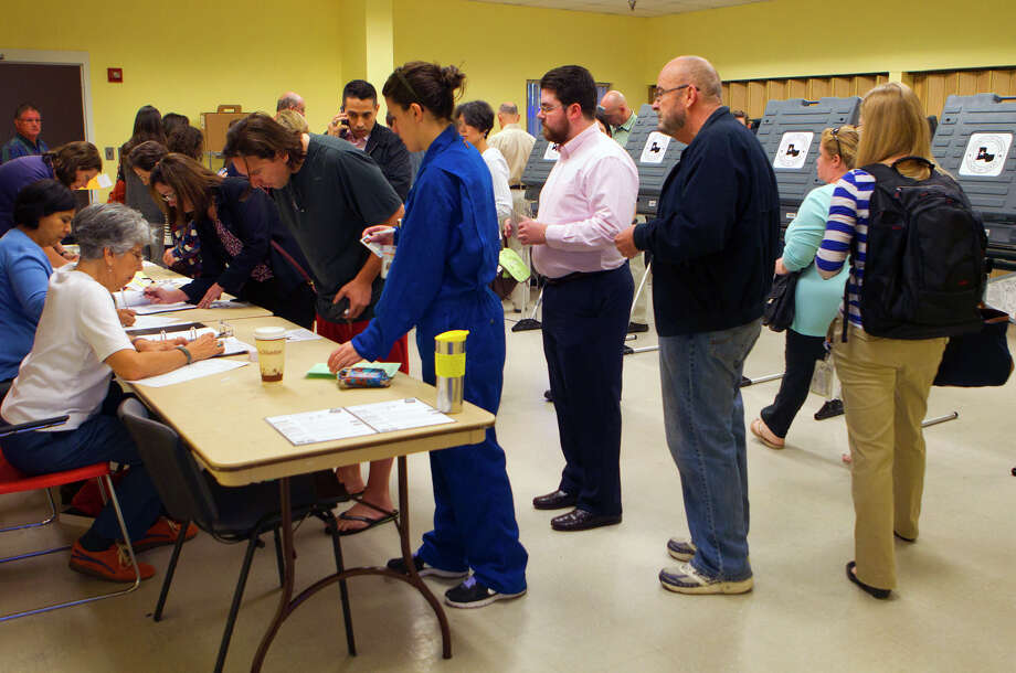 Voters wait to vote inside the West Gray Recreation Center Tuesday, Nov. 6, 2012, in Houston. Photo: Cody Duty, Houston Chronicle / © 2012 Houston Chronicle