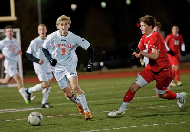Ridgefield high school's John Findlay moves the ball upfield in the FCIAC boy's soccer semifinal game against Greenwich high school held at Fairfield Ludlowe high school, Fairfield, CT on Tuesday November 6th, 2012. Photo: Mark Conrad / Stamford Advocate Freelance