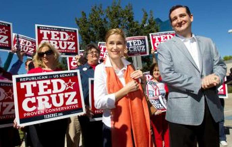 Ted Cruz, Republican candidate for U.S. Senate, right, stands with his wife, Heidi, as he speaks to supporters during a campaign stop outside St. Martin's Episcopal Church Tuesday, Nov. 6, 2012, in Houston. Photo: Brett Coomer, Houston Chronicle /  2012 Houston Chronicle
