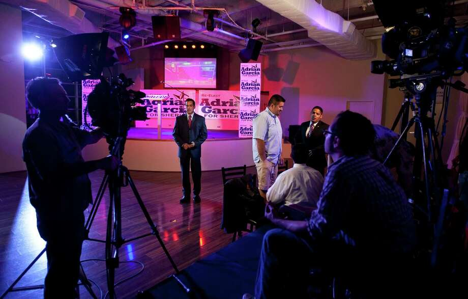Members of the local media prepare for shots and watch polling websites as they cover Harris County Sheriff Adrian Garcia's Election Night party. ( Nick de la Torre / Houston Chronicle ) Photo: Nick De La Torre, Staff / © 2012  Houston Chronicle