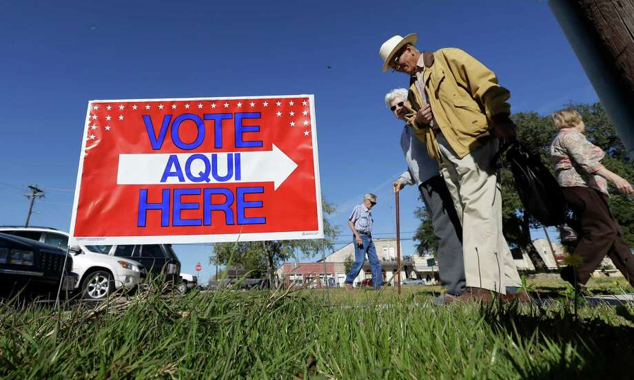 FILE - Voters leave the Old Blanco Courthouse after casting their ballots, Tuesday, Nov. 6, 2012, in Blanco, Texas. (AP Photo/Eric Gay) Photo: Eric Gay, STF / AP