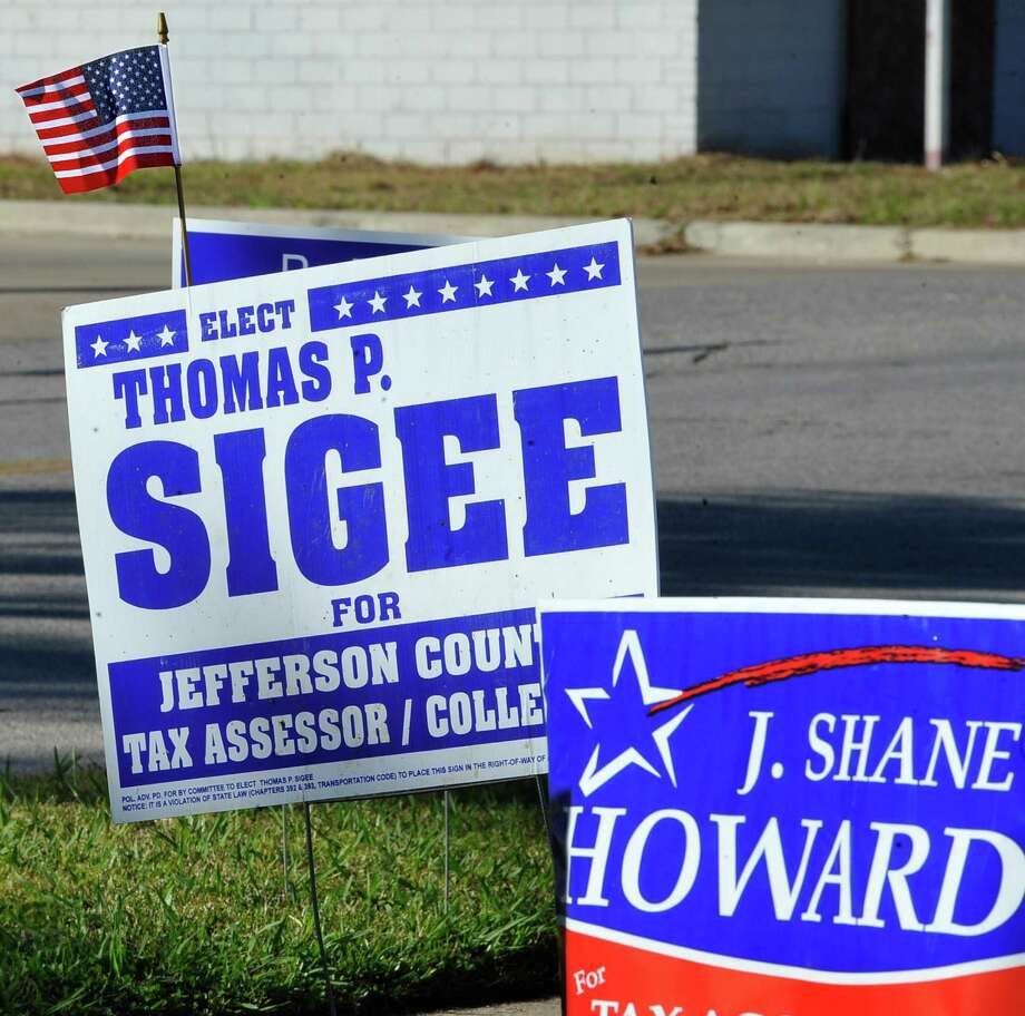 "It's Election Day and over at Precinct 3,  the Sterling Pruitt Center, a flag sits on top of all the Sigee signs to go along with his ""a veteran for veterans"" campaign slogan.    Dave Ryan/The Enterprise"