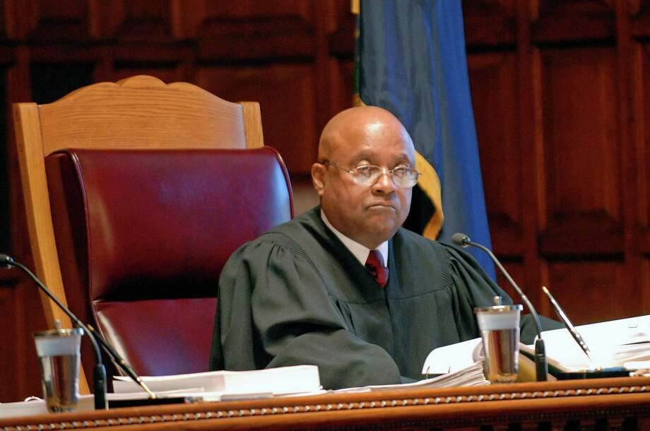 FILE - In this Nov. 20, 2008 file photo, Associate Judge Theodore Jones Jr., listens to oral arguments at the New York Court of Appeals in Albany, N.Y. Court officials said Tuesday, Nov. 6, 2012, that Jones died of an apparent heart attack Monday night at home in Rockland County. He became a state Supreme Court Justice in Brooklyn in 1990 and joined the Court of Appeals in 2007 after being nominated by Gov. Eliot Spitzer. (AP Photo/Hans Pennink, File) Photo: Hans Pennink