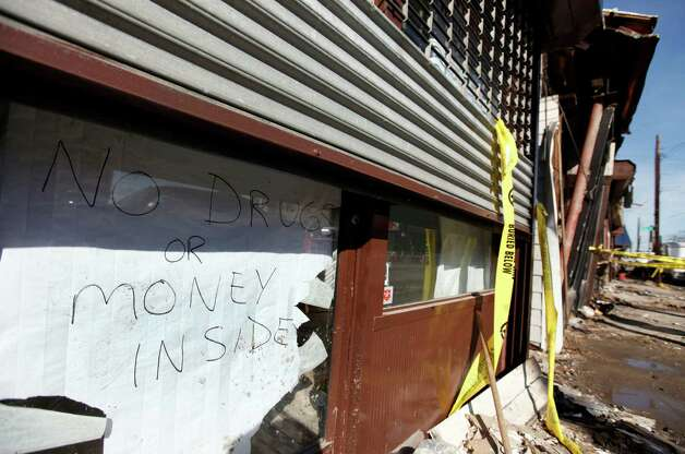 A sign proclaiming a lack of valuables inside is posted in the door of a veterinary clinic on a storm and fire ravaged block in Rockaway Beach, Tuesday, Nov. 6, 2012, in the the Queens borough of New York. Weather experts have some good news for beleaguered coastal residents in the Northeast: A new storm that threatened to complicate Hurricane Sandy cleanup efforts now looks like it will be weaker than expected.(AP Photo/Jason DeCrow) Photo: Jason DeCrow