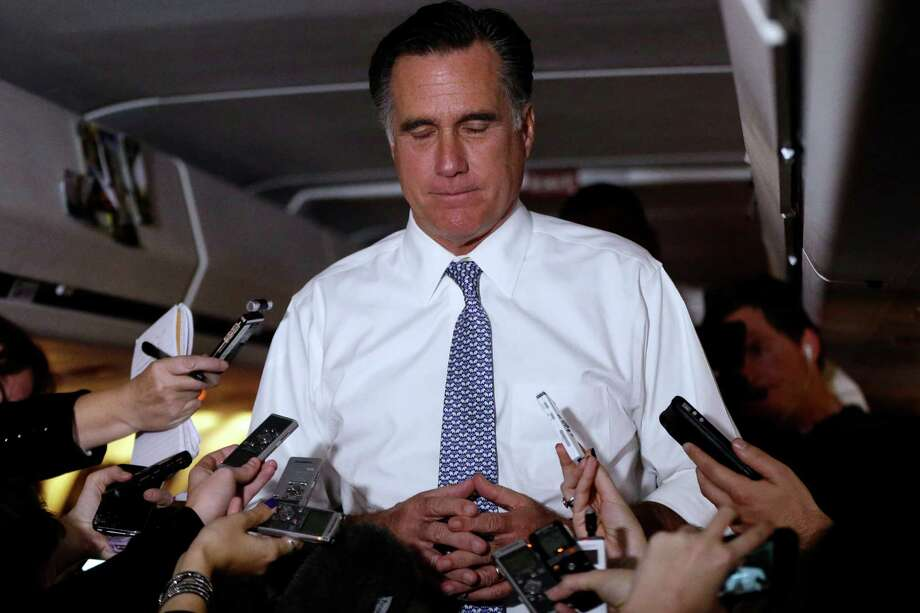 Republican presidential candidate and former Massachusetts Gov. Mitt Romney pauses as he speaks to reporters on his campaign plane en route from Pittsburgh to Boston, Tuesday, Nov. 6, 2012. (AP Photo/Charles Dharapak) Photo: Charles Dharapak, STF / AP