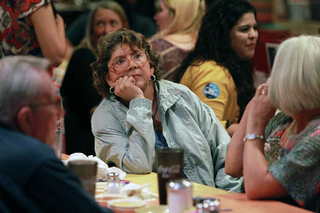 Elia Garcia keeps an intense eye on national results at the election night watch party for State Representative Pete Gallego, D-Alpine, who is challenging U.S. Representative Francisco Canseco for his seat in the U.S. House District 23  on November 6, 2012. Photo: Tom Reel, San Antonio Express-News / ©2012 San Antono Express-News