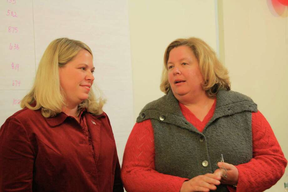 Sarah Schneider-Zurp and Elizabeth Hagerty-Ross give their victory speech at the Republican Town Committee Meeting Headquarters in Darien. Nov. 6, 2012. Photo: Megan Davis