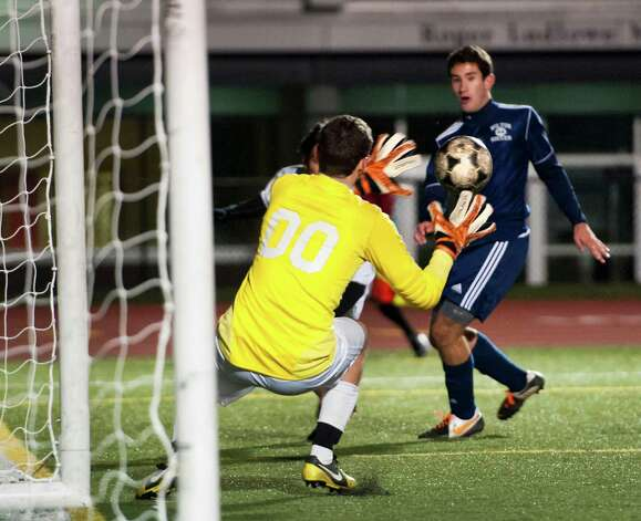 Wilton high school goalie Peter Como makes a save in the FCIAC boy's soccer semifinal game against Norwalk high school held at Fairfield Ludlowe high school, Fairfield, CT on Tuesday November 6th, 2012. Photo: Mark Conrad / Stamford Advocate Freelance