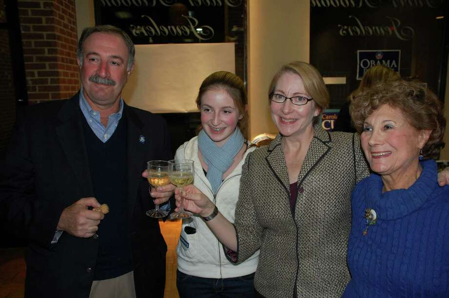 State Rep. Jonathan Steinberg toasts his victory with family members Tuesday night. From left are Steinberg, his daughter Charlotte, wife Nancy and mother Sybil Steinberg Photo: Contributed Photo, Jarrtet Liotta/Contributed Photo / Westport News