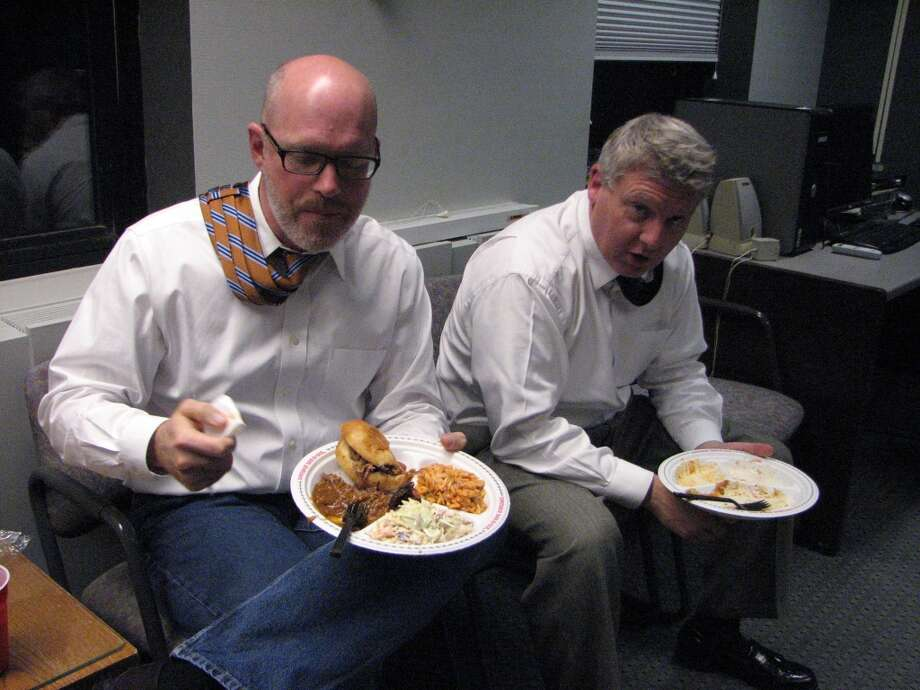 State Editor Casey Seiler and City Editor Mike Goodwin stash their ties behind their necks and enjoy one of the last remaining newsroom traditions: free dinner on election night. We dined on some killer Dinosaur BBQ this year. Special thanks to the custodial dudes who cleaned up the debris, avoiding the day after election tradition of smelling leftover food.