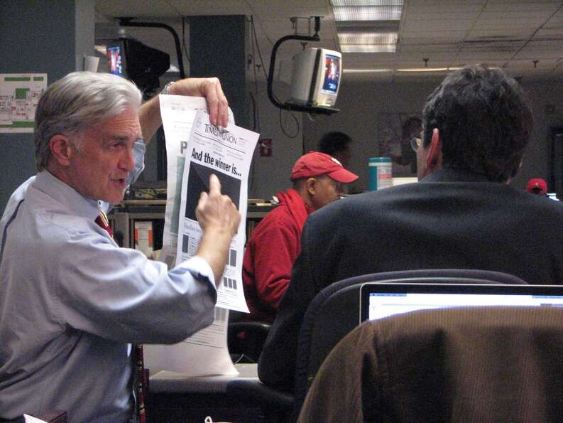 Editor Rex Smith shows the mockup of Wednesday's front page. 'And the winnner is...' As I write this